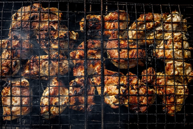Meat is fried on the grill. the wire rack with roasted pork