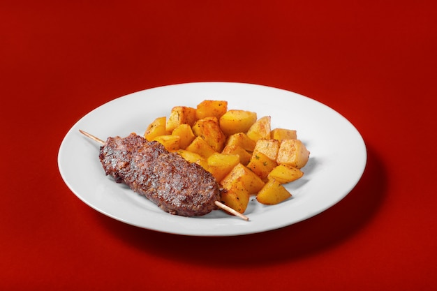 Meat kebab with fried potatoes for the menu