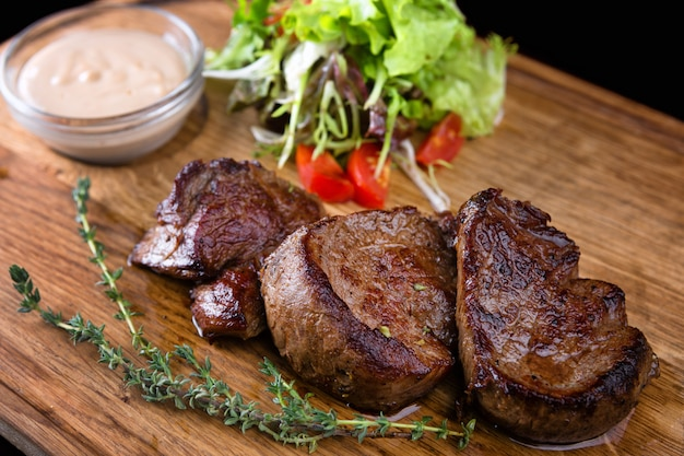 Meat medallions with sauce