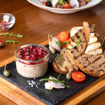 Meat pate with cranberry sauce and crispy bread