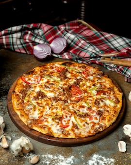 Meat pizza with bell peppers tomato and cheese