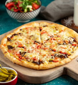 Meat pizza with tomato bell peppers cheese