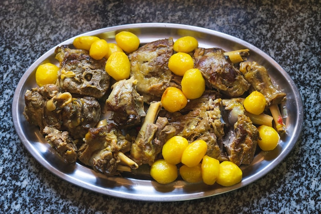 Meat and potato stew on a tray.