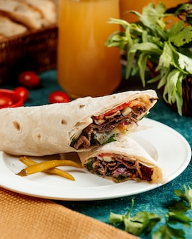 Meat roll in pita bread and pepper