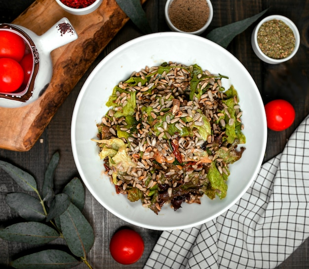 Meat salad with lettuce sprinkled with peeled seeds