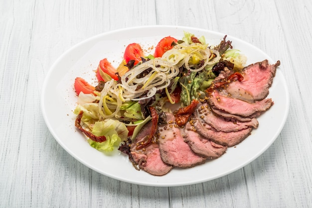 Meat salad with vegetable and sesame spanish kitchen