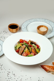 Meat salad with vegetables on the table Free Photo