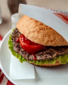 Meat sandwich  lettuce  tomato  side view