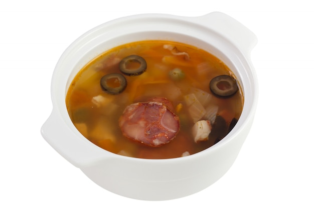 Meat soup in the bowl on white background