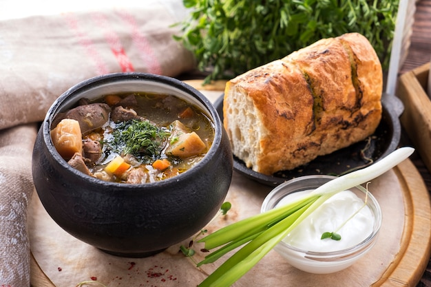 Meat soup with vegetables in a pot.
