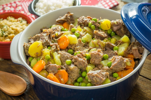 Meat stew with vegetables in bowl.