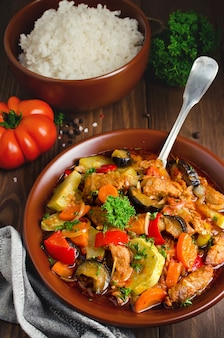 Meat stew with with eggplant, carrots, onions, peppers and zucchini