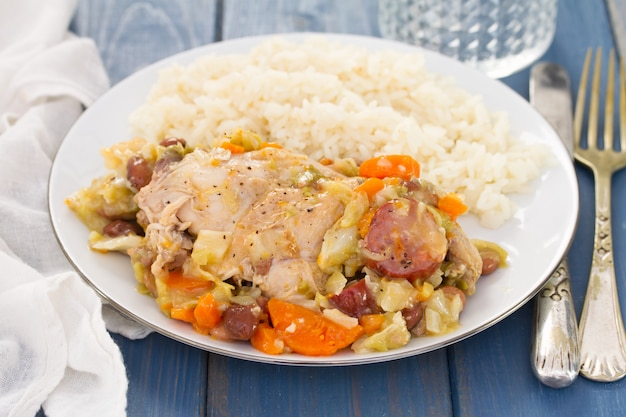 Meat with cabbage, beans and smoked sausages