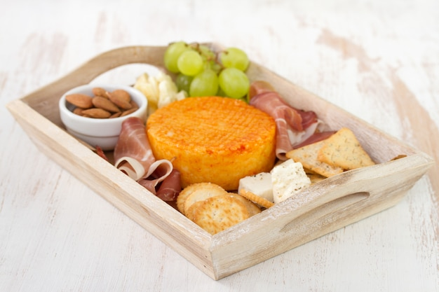 Meat with cheese and fruits