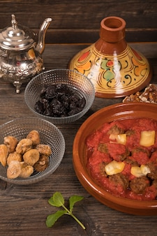 Meat with dried fruits and teapot