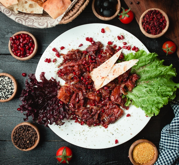 Meat with lavash and pomegranate