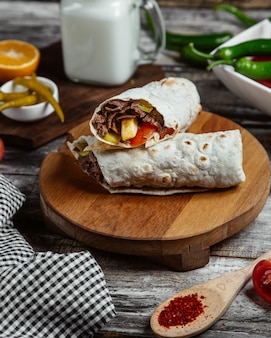 Meat wrap served with pepper