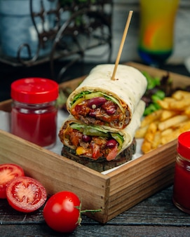 Meat wrap with ketchup and fries