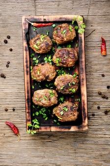 Meatballs on cutting board