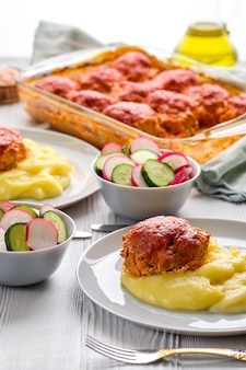 Meatballs and mashed potato.