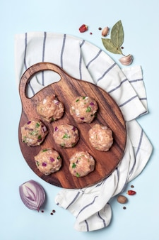 Meatballs of minced chicken meat on cutting board. cooking concept