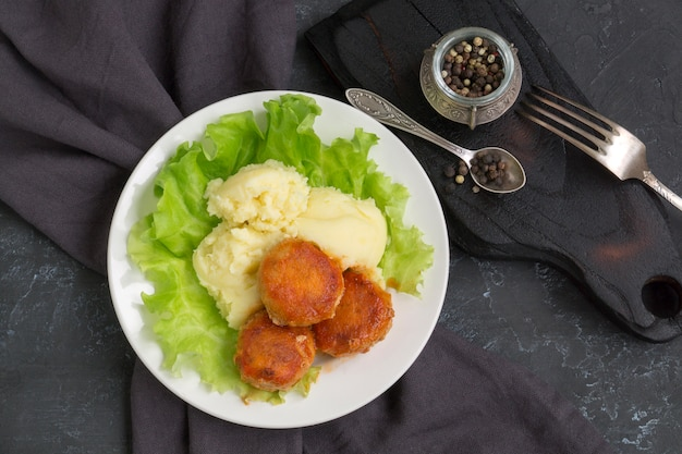 Meatballs in sweet and sour tomato sauce with mashed potatoes.