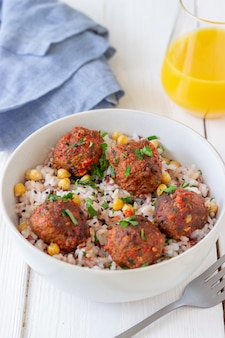 Meatballs with rice, chickpea and sesame seeds.