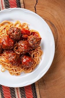 Meatballs with tomato sauce and pasta. top view - almondegas