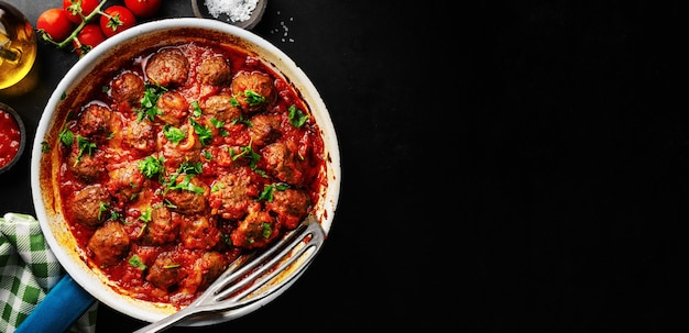 Meatballs with tomato sauce served in pan
