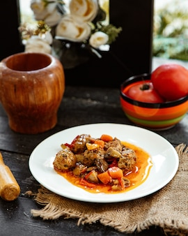 Meatballs with vegetables mushrooms in sauce