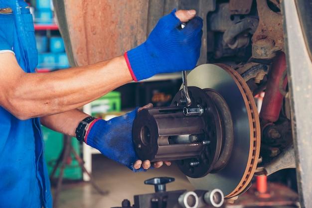 Mechanic car service auto garage in automotive mobile center.