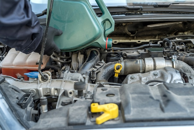 Mechanic change oil to engine, car servicing. vichile repair