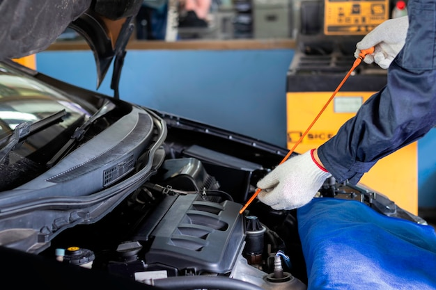 Mechanic checking  the oil