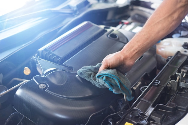 Mechanic cleaning car engine