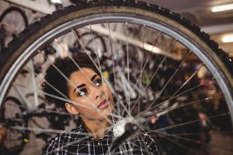 Mechanic examining a bicycle wheel