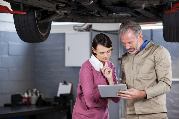 Mechanic explaining quotation to a customer