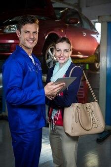 Mechanic explaining quotation to a customer