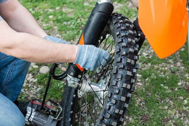 Mechanic fixing motorcycle wheel