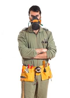 Mechanic in gas mask