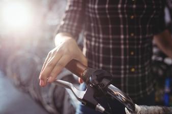Mechanic holding a bicycle handlebar