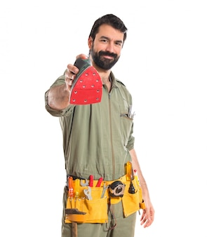 Mechanic holding a sander machine
