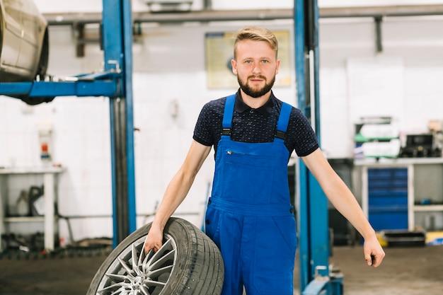 Mechanic holding tire