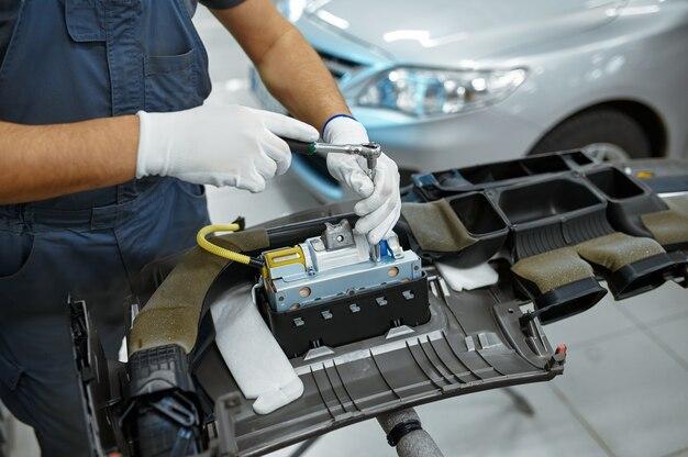 Mechanic man fixes problem in mechanical workshop