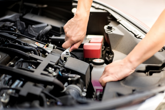 Mechanic man working and repair car engine in car service centre.automobile metal car engine part details. of modern vehicle motor,  industry,mechanic and business.