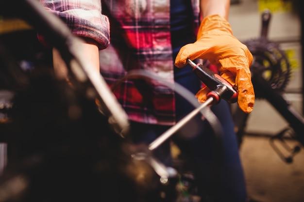 Mechanic repairing a bicycle