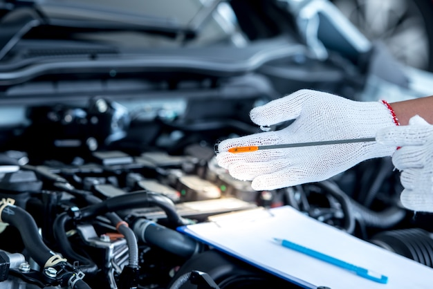 Mechanic repairing car with open hood