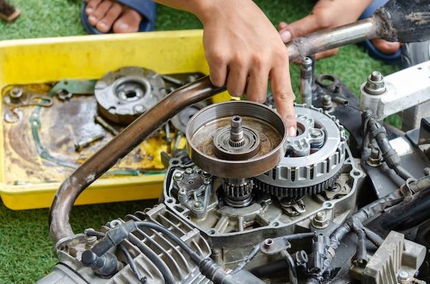 Mechanic repairing a motorcycle engine