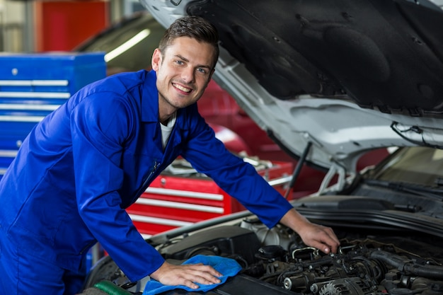 Mechanic servicing a car engine