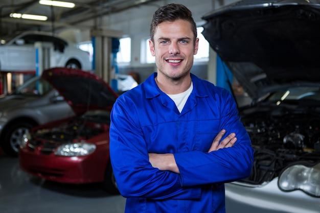 Mechanic standing at repair garage