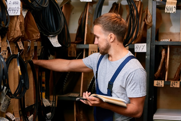 Mechanic in storage room